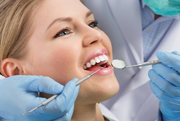 patient receiving tooth whitening treatment